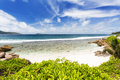 Anse banane la digue seychelles in with clear water and white sand Royalty Free Stock Image