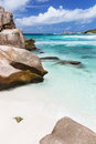 Anse cocos la digue seychelles granite boulders and turquoise water at in Stock Photography