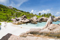 Anse cocos la digue seychelles granite rock formations and turquoise water at in Stock Image