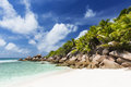 Anse cocos la digue seychelles perfect white beach in with granite boulders and palm trees Royalty Free Stock Photo