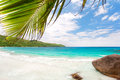 Anse lazio beach on praslin island in seychelles excellent seascape view with big stones and palm tree Royalty Free Stock Photo