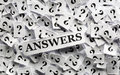 Answers on question marks white papers hard light Royalty Free Stock Photo