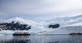 Antarctic landscape with ship in front of glacier Stock Images