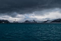 Antarctic seascape low clouds drift over the peninsula this region though cold harbors plenty of wildlife Royalty Free Stock Image