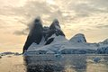 Antarctic sunset at una peaks formerly known as cape renard towers are two towers of basalt each topped by a cap of ice guarding Stock Photo