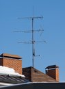 Antenna on the roof in sunny midday against bleu sky Royalty Free Stock Image