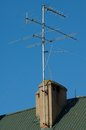 Antenna on the roof in sunny midday against bleu sky Stock Photos