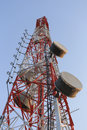 Antenna for Telephone communications in bright sky day time. Royalty Free Stock Photo