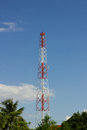 Antenna tower of communication in background of blue sky and cl cloud Stock Photo