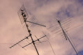 Antennas above a pink sky on polluted in rome italy Stock Photos