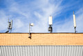 Antennas cellular communication on a building roof Royalty Free Stock Image