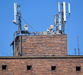 Antennas on the top of an old warehouse building brick Royalty Free Stock Photo