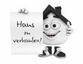 An anthropomorphic house with the sign haus zu verkaufen for a house for sale Stock Photos