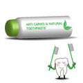 Anti caries toothpaste tube with the text and natural and a small tooth holding toothbrushes Royalty Free Stock Image