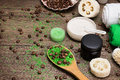 Anti cellulite cosmetics with caffeine on wooden surface spoon green sea salt and coffee beans natural body scrubs skin care cream Royalty Free Stock Photography