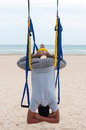 Anti gravity yoga man doing yoga exercises or fly yoga on the sea background Royalty Free Stock Photography