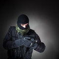 Anti terrorist unit policeman during mission special forces or contractor night cqb operation color toned image very harsh Stock Photo