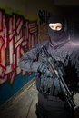 Anti terrorist unit policeman during night mission special forces or contractor cqb operation color toned image very harsh Stock Photo