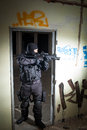 Anti terrorist unit policeman during the night mission special forces or contractor cqb operation color toned image very harsh Royalty Free Stock Photography