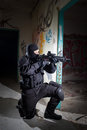 Anti terrorist unit policeman during the night mission special forces or contractor cqb operation color toned image very harsh Stock Images
