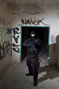 Anti terrorist unit policeman during the night mission special forces or contractor cqb operation color toned image very harsh Royalty Free Stock Images