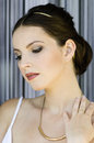 Antic girl looking down beautiful with make up hairstyling and visage Royalty Free Stock Photography