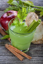 Antioxidant juices juice made from celery apples and cinnamon Stock Photo