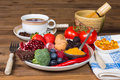 Antioxidants for breakfast table with a plate filled with fruits and vegetables Stock Photos