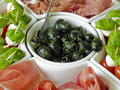 Antipasti with olives plate caprese and ham Stock Images