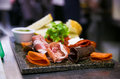 Antipasti with parma ham salami mozzarella and bread Royalty Free Stock Photos
