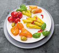 Antipasti vegetables peppers with cream cheese hot olives in plate on gray background Royalty Free Stock Images