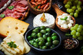 Antipasto and catering platter with different meat cheese products Royalty Free Stock Images
