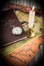 Antiquarian pocket watch and ancient world maps Stock Photo