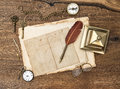 Antique accessories and office supplies on wooden table over background vintage keys clock glasses feather pen compass nostalgic Stock Photos