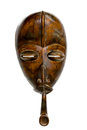 Antique african congolse mask s with a pipe in his mouth on a white background Royalty Free Stock Images