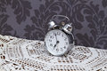 Antique alarm clock on table cloth vintage concept Royalty Free Stock Images