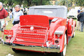 Antique american car rear view of showing exterior trunk on and open rumble seat red packard convertible parked on grass with Stock Photo