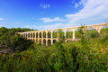 Antique aqueduct in summer forest tarragona catalonia Stock Photo
