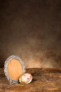 Antique baroque empty photo frame and a vintage cameo brooch Stock Images