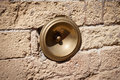Antique bell calling porter italy on the wall Stock Photography