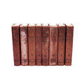 Antique book covers on white background. eight volumes of antique books with numbers from 1 to 8. Rare collection Royalty Free Stock Photo