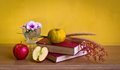 Antique book with flower and fruit wild on table yellow wall Stock Photos