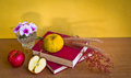 Antique book with flower and fruit wild on table yellow wall Royalty Free Stock Photo