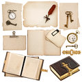 Antique book and vintage accessories isolated on white background old clock key postcard photo album feather pen Stock Photo