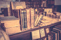 Antique books in antiquarian bookshop Royalty Free Stock Photo