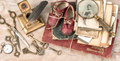 Antique books and photos, keys, baby shoes and writing accessori Royalty Free Stock Photo