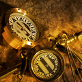 Antique brass compasses Stock Photos