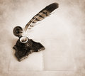 Antique brass inkwell with feather Royalty Free Stock Photo