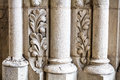 Antique building`s detail of white limestone pillars or columns Royalty Free Stock Photo