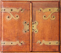 Antique cabinet doors wood with brass hinges and lock Royalty Free Stock Image